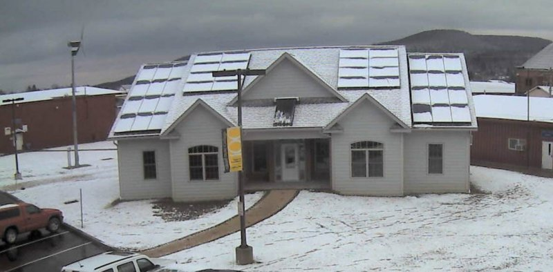 Zero energy green home with snow on roof