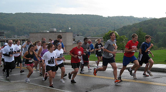 Students, faculty, and staff running in the two-mile road race/walk for the tenth anniversary of 9-11