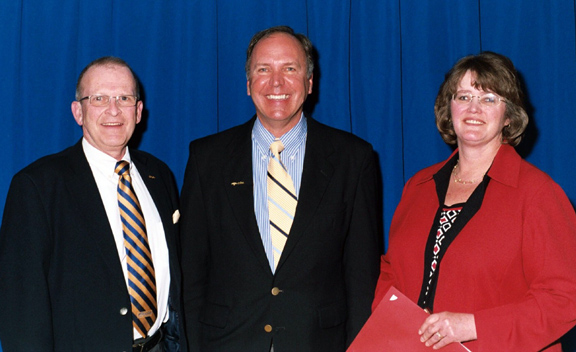Joseph Damrath, President Dr. John M. Anderson, and April Lawrence