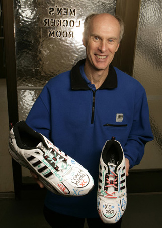 Coach Gary Moore with autographed running shoes