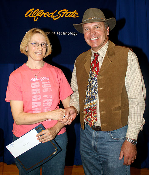 Alfred State College President Dr. John M. Anderson, right, congratulates Goodwin on her award.
