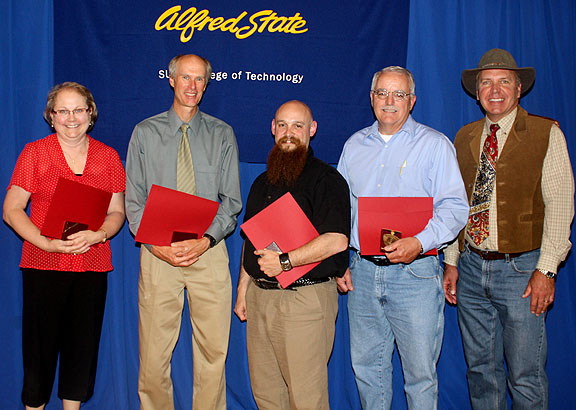 L-r: Joanne White, Gary Moore, Christopher Tomasi, Cyril (Skip) Merrick, and President Dr. John M. Anderson