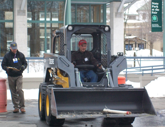 Senior David Raynor operates the skid steer.