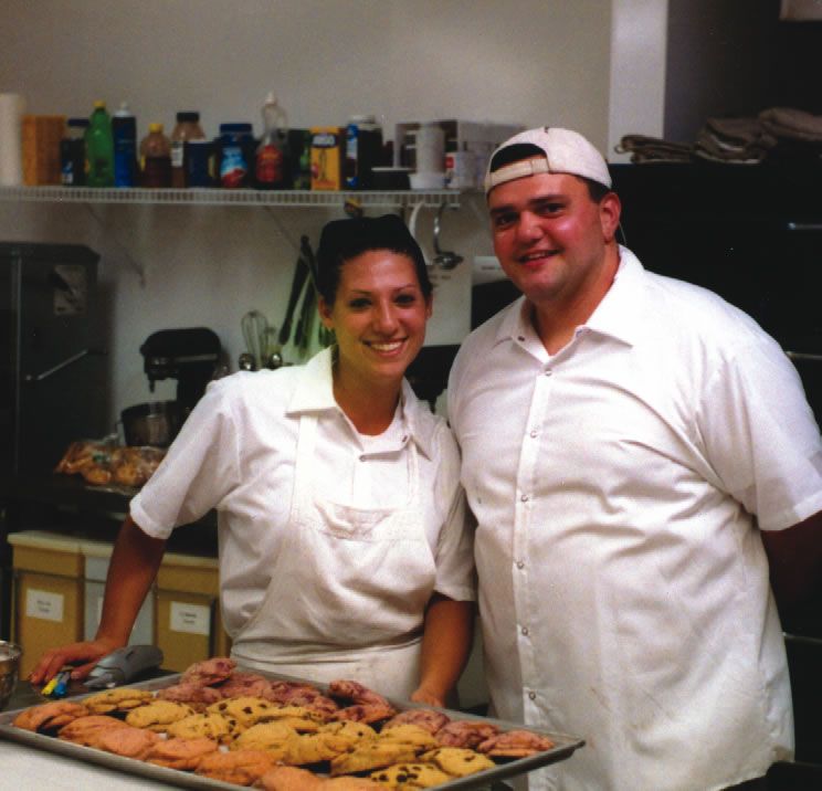Jamie Hetzelt-Wells and husband Darren in their bakery
