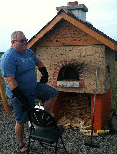 Pastor Wright next to the pizza oven.