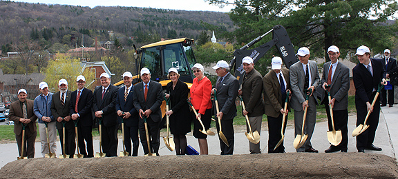 Student Leadership Center ground breaking ceremony - dignitaries holding golden shovels standing near a pile of dirt
