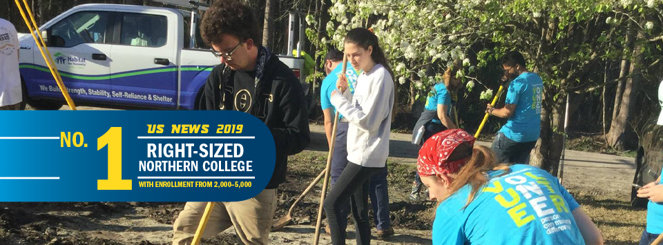 No. 1 Right-Sized Norther College with Enrollment from 2,000-5,000 US News 2019. Image of student volunteers working with shovels