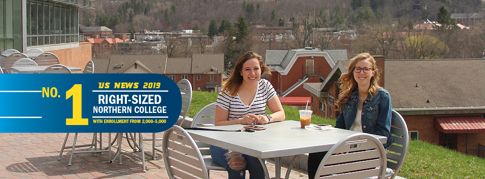 No. 1 Right-Sized Norther College with Enrollment from 2,000-5,000 US News 2019. Image of two students sitting outside at metal tables with drinks.