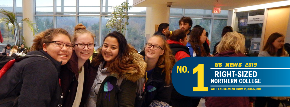 No. 1 Right-Sized Norther College with Enrollment from 2,000-5,000 US News 2019. Image of girls in the SLC smiling with backpacks.