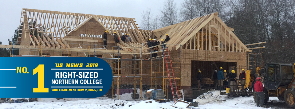 No. 1 Right-Sized Norther College with Enrollment from 2,000-5,000 US News 2019. Image of building trades students on location at framed in home with hard hats and scaffolding