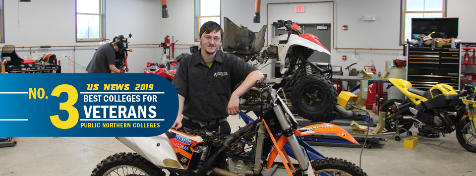US News 2019 No. 3 Best Colleges for Veterans, public northern colleges. Image of motorcycle and power sports technology students working.