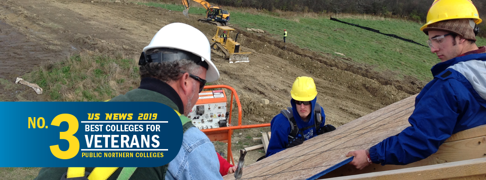US News 2019 No. 3 Best Colleges for Veterans, public northern colleges. Image of building trades students working on a roof with heavy equipment in the background.