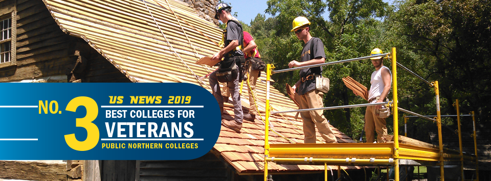 US News 2019 No. 3 Best Colleges for Veterans, public northern colleges. Image of building trades students working on a roof.