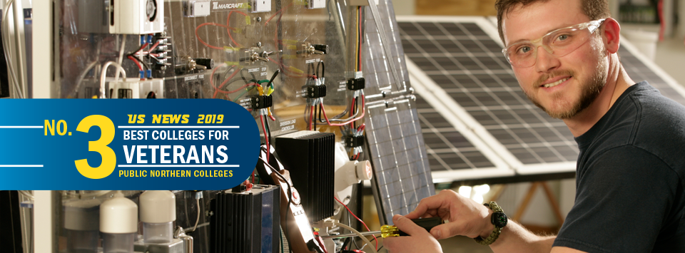 US News 2019 No. 3 Best Colleges for Veterans, public northern colleges. Image of electrical trades student working on solar system.