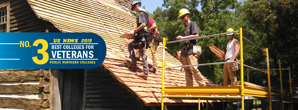 US News 2019 No. 3 Best Colleges for Veterans, public northern colleges. Image of building trades students on scaffolding working on roof.