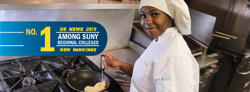 No. 1 among SUNY regional colleges, US News 2019 new rankings. Image of culinary student in white uniform and hat testing chicken with thermometer.