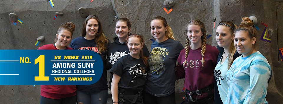 No. 1 Among SUNY Regional Colleges US News 2019 New Rankings. Image of girls in front of the rock wall.