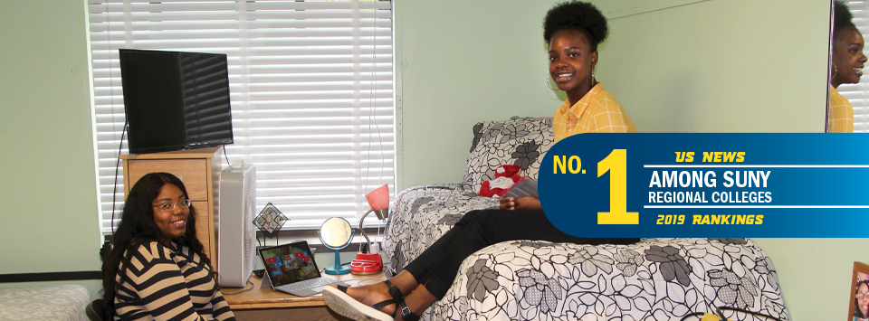 No. 1 among SUNY regional colleges, US News 2019 new rankings. Image of 2 students in their dorm room.