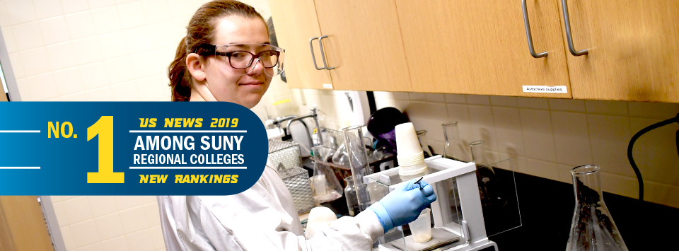 No. 1 among SUNY regional colleges, US News 2019 new rankings. Image of girl with white coat and safety glasses in lab.