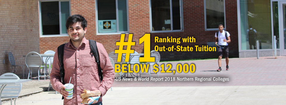 #1 ranking with Out-of-State Tuition Below $12,000 - US News & World Report, 2018 Northern Regional Colleges. Image of male students walking on sidewalk, one holding food and drink.