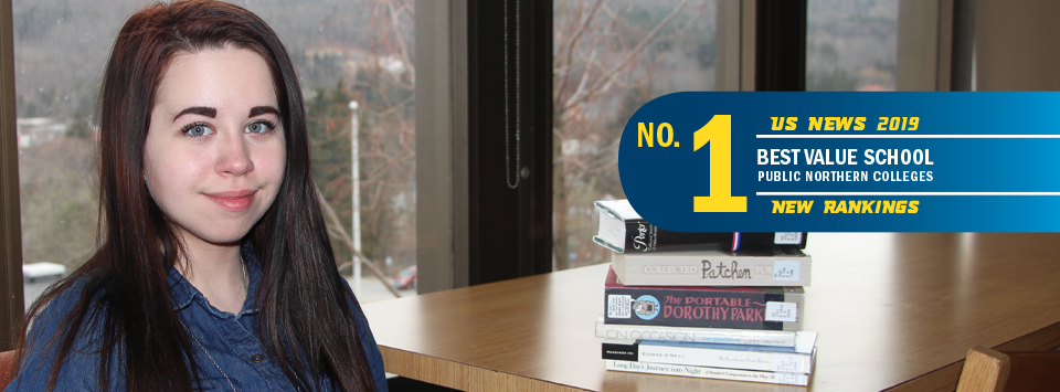No. 1 Best Value School public northern colleges US News 2019 new rankings. Image of student in library with books and window behind her.