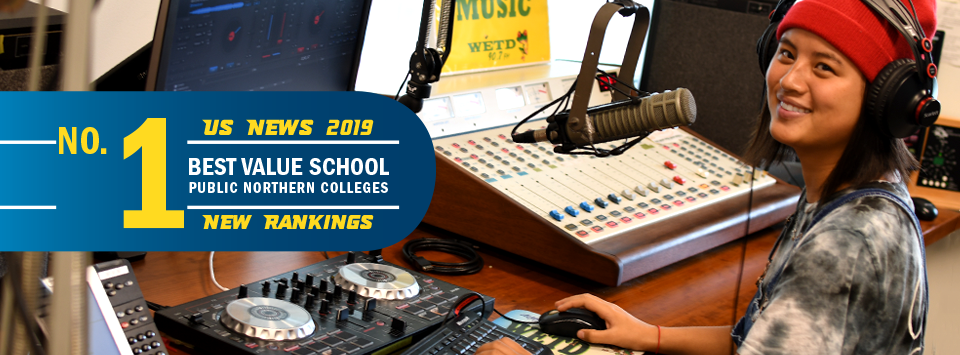 No. 1 Best Value School public northern colleges US News 2019 new rankings. Image of D.J. at WETD radio station wearing headphones and talking into microphone
