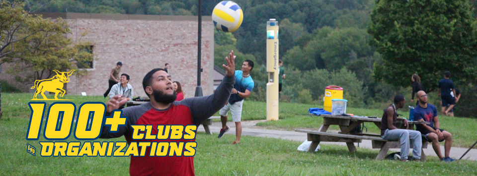 100+ Clubs and Organizations. Image of students playing volleyball and unlit mate frisbee on the campus lawn.