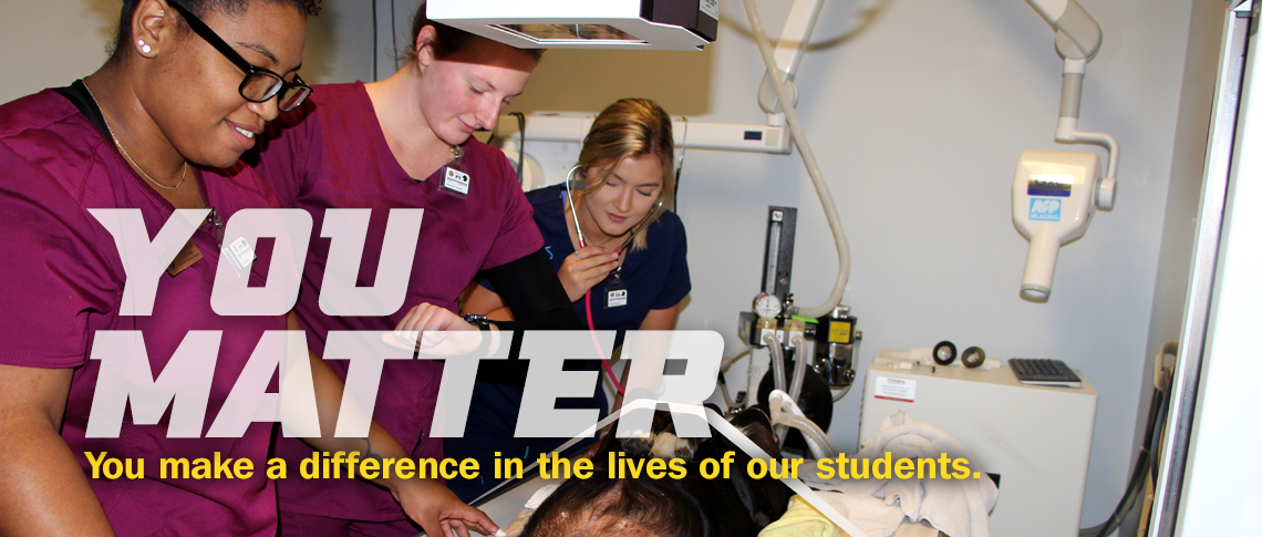 YOU MATTER. You make a difference in the lives of our students. Image of Vet Tech students with dog in x-ray lab.