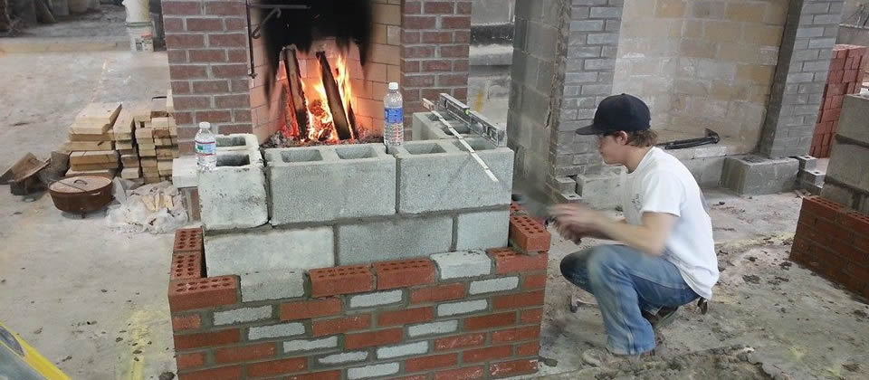 student building a fireplace