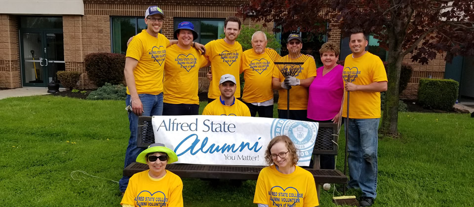 several alumni wearing yellow shirts