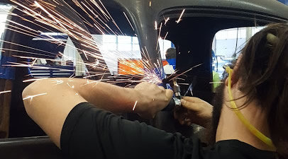 sparks, student working on a vehicle