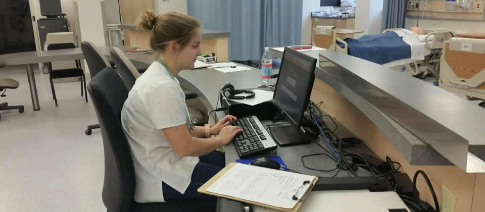 female student sitting at a desk