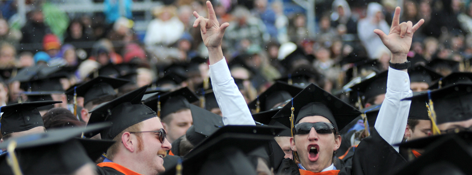 student cheering at commencement