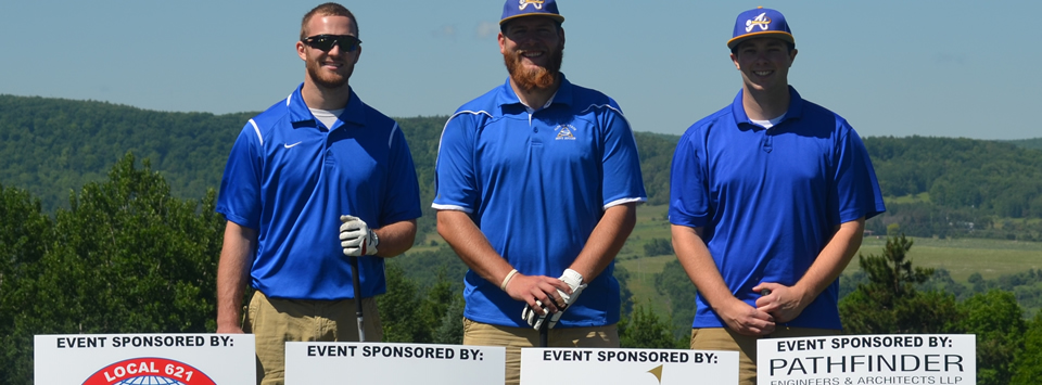 three males at golf tournament