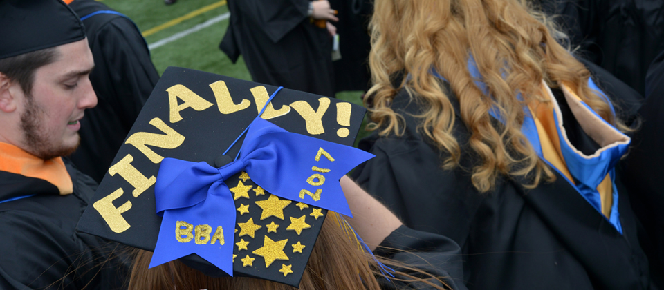 Commencement cap that says 'finally!'