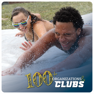 Link to Student clubs and organizations. 100+ organizations and clubs. Image of two students enjoying the slip and slide with water droplets.