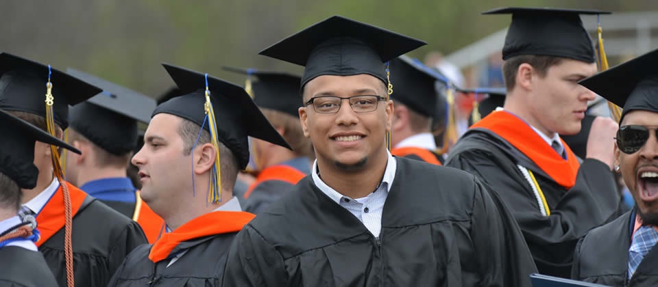 male student wearing his commencement cap and gown