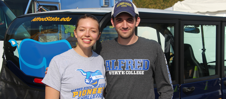 male and a female wearing Alfred State t-shirts