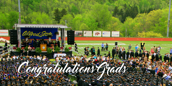 congratulations grads - image of Pioneer Stadium with stage and students sitting in chairs