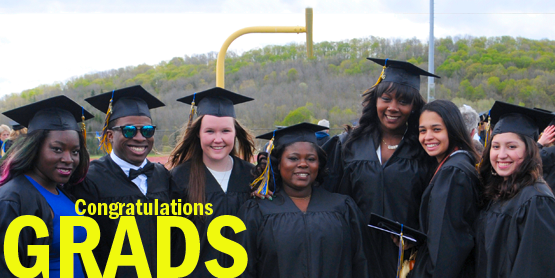 Congratulations Grads, seven students in their cap and gown