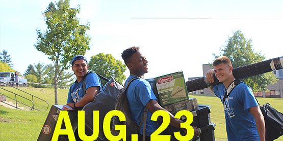 Aug. 23, image of 3 male students carrying items to move into residence hall