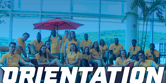 students wearing yellow shirts. orientation