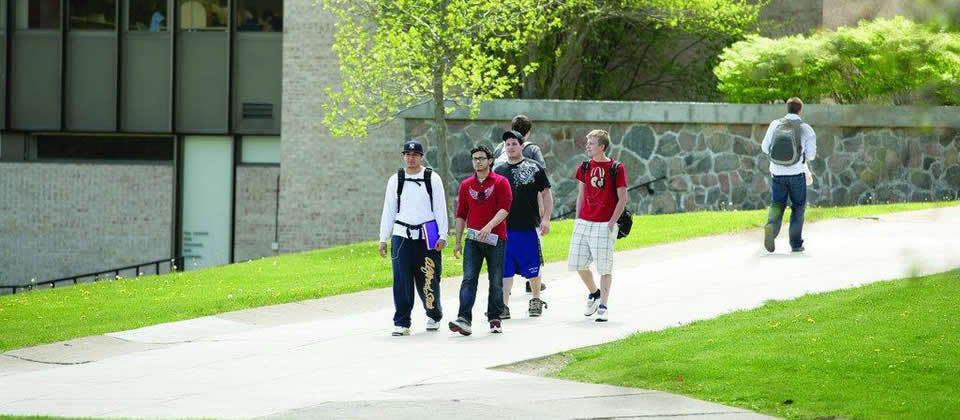 students walking down the center of campus