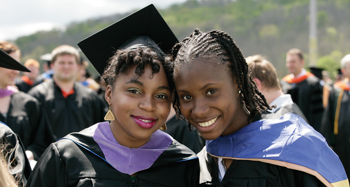 2 female students at commencement