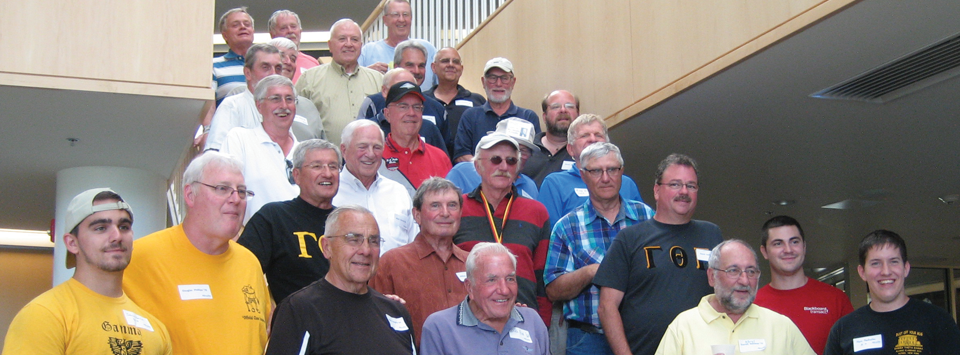 several male Theta Gamma alumni on stairs of the Central Dining Hall