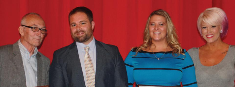 2 male and 2 female alumni athletic award winners