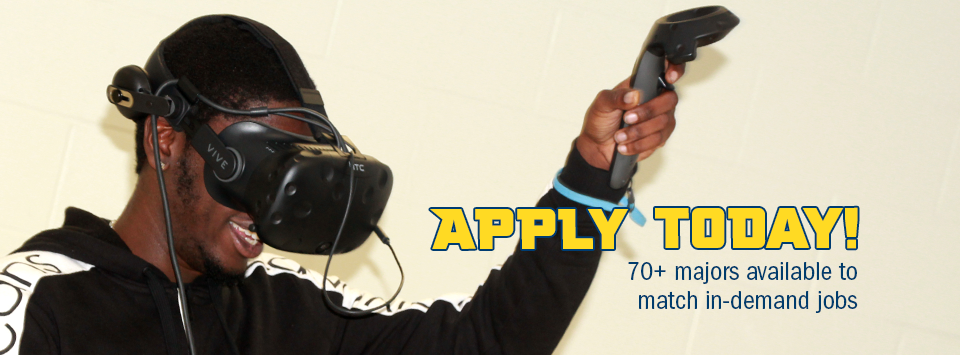Apply Today! 70+ majors available to match in-demand jobs. Image of student using virtual reality goggles.