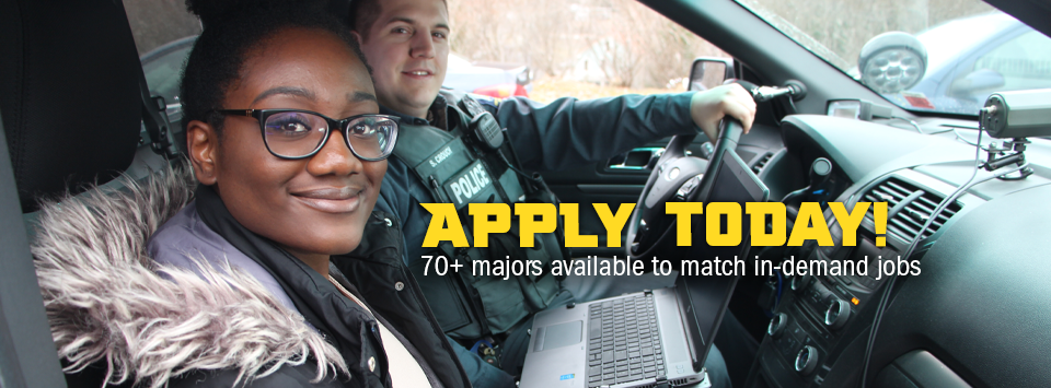 Apply Today! 70+ majors available to match in-demand jobs. Image of criminal justice student with a police officer in his car with a computer