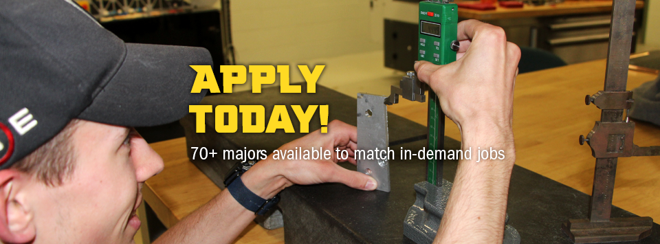 Apply Today! 70+ majors available to match in-demand jobs. Image of engineering student taking a measurement.