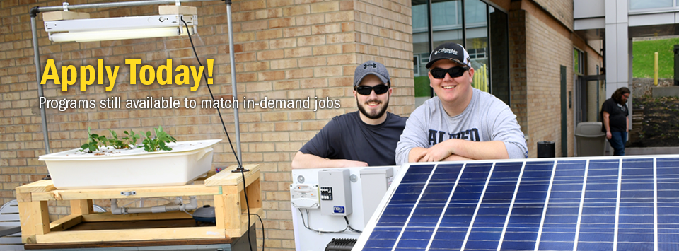 Apply Today! Programs still available to match in-demand jobs. Image of two students with a solar panel powering a planting system.
